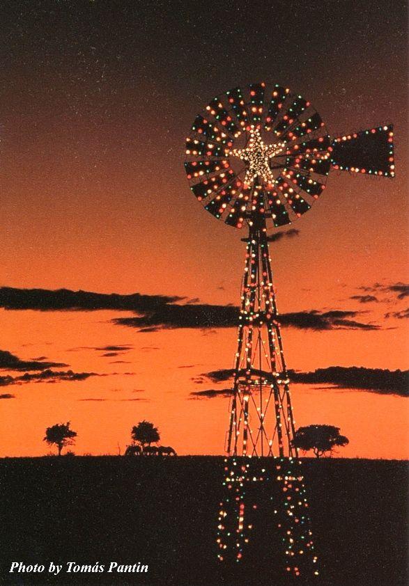Christmas lights on the plains. Windmill covered with Christmas lights for an outdoor Christmas light display. More