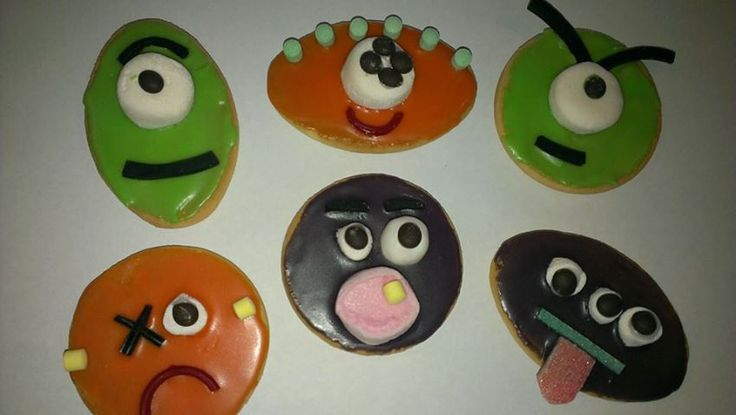Monster biscuits! Milk arrowroot or Marie biscuits decorated with coloured icing and lollies. Perfect for Halloween or birthday parties! More ideas at Yibba Yabba Mama Facebook page!