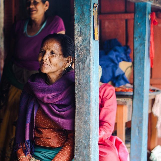 """""""These ladies immediately invited us under their shelter from the rain and welcomed us warmly. Despite the language barrier, they kept smiling and trying to make conversation. So when I asked for a portrait, without hesitation one of them just smiled and gestured with her head in the Nepali style that means 'Okay.'"""" - @syazreen.ghazali Sarangkot, Nepal #passionpassport"""