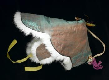 Nambawi  Hat  Hat with an open top and ear flaps, of slubbed red and green silk outside and dark green wool inside, trimmed with white fur with a yellow silk tie under chin.  Nambawi is a type of traditional Korean winter hat worn by both men and women during the Joseon period for protection against the cold. It was usually worn by middle-aged women and old people as well as by government officers who put it under the 'samo' (official hat)