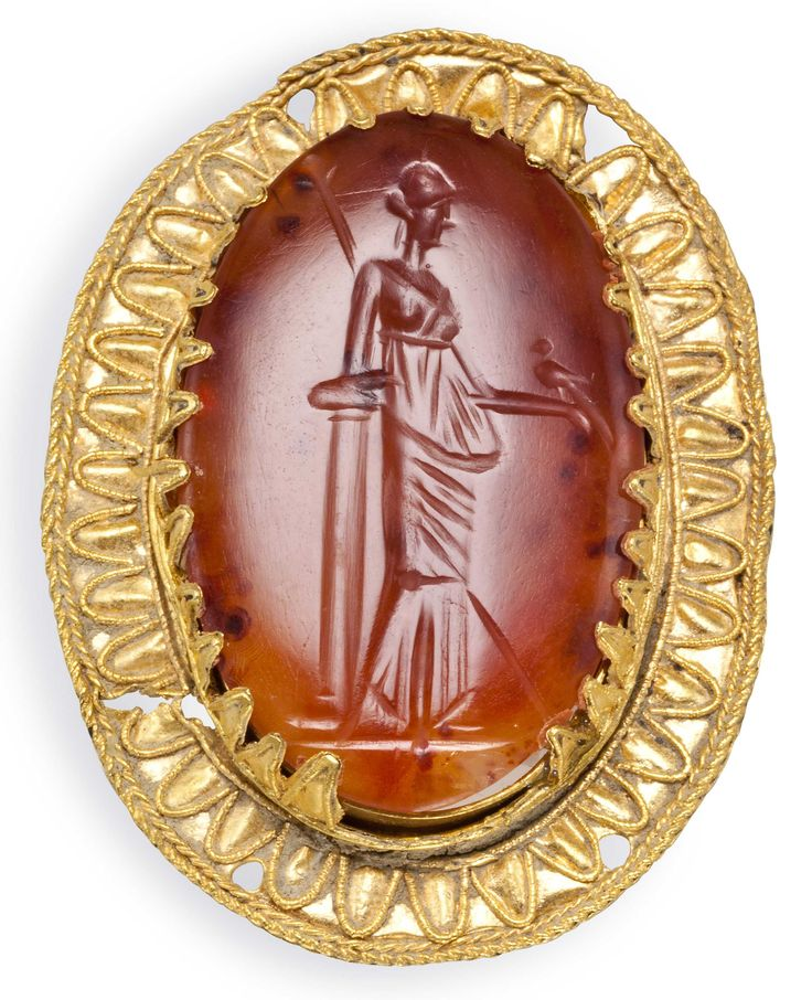 A Greek gold and carnelian brooch, 2nd century BC.