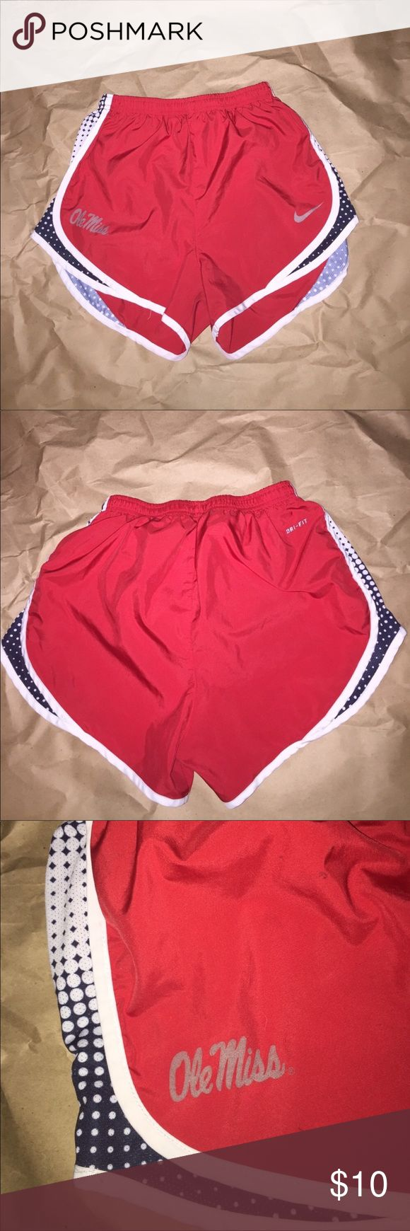 Nike Ole Miss Running Shorts lined size Small Women's small Red white and navy blue and gray  Ole Miss Nike dry fit running or workout athletic shorts. Inside is lined with brief. 💕price firm $10💕 gently worn no smells no stains or holes. Perfect Nike dri fit running shorts for Mississippi fan! 💕price firm ships next day Nike Shorts