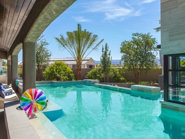 Drew and Jonathan Scott turned the backyard of their Las Vegas home into an over-the-top outdoor playground. See all the coolest features right here.  From the experts at HGTV.com.
