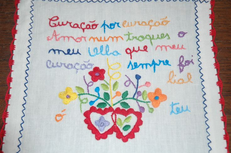 """Portuguese traditional courtship handkerchiefs often have a poem written in them, in a """"popular"""" variety of Portuguese, ridden with grammatical errors. This one roughly reads: """"Heart for heart, / Love don't trade mine away, / As it was always loyal to yours"""" (the errors are not translated)."""