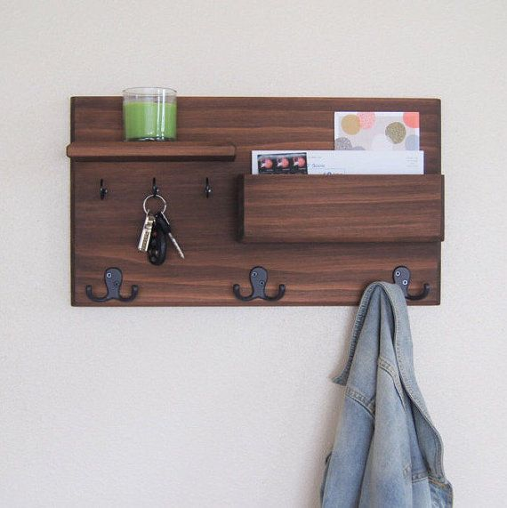 Keep your home stylishly organized with this wall coat rack, a Midnight Woodworks original design. Our handcrafted entryway organizer is an excellent entryway storage solution. Perfect for mail, keys, coats, backpacks and other necessities! The pictured custom built flush-mount one-shelf organizer is made using solid wood stained Chestnut but can be custom ordered, see photo #5 for options. Three oil rubbed bronze double coat hooks provide storage for your bags, backpacks and other…