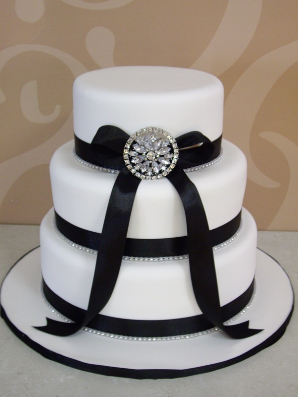 Cake idea, with no bow, and pearls instead of rhinestones. Letter topper.