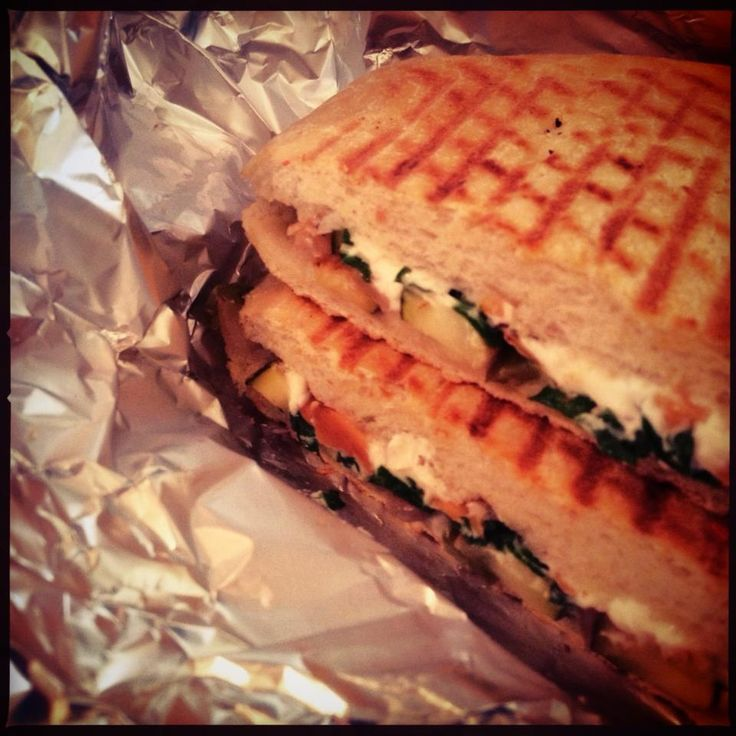 Veggie delight panini with local organic kale, natural okanagan chreve, toasted almonds and garlic aioli.