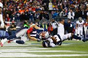 Julian Edelman #11 of the New England Patriots scores a touchdown as he is defended by T.J. Ward #43 of the Denver Broncos during the second quarter at Gillette Stadium on November 2, 2014 in Foxboro, Massachusetts.