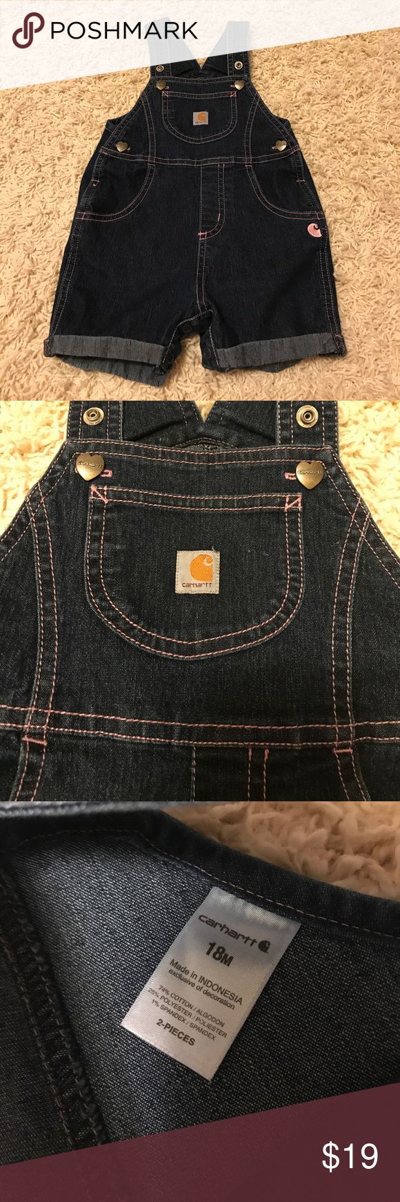 18 months Carhartt overalls Worn very very few times- maybe 3. Perfect condition . So cute with pink thread's, heart snap details, and two options for snapping the straps Carhartt One Pieces