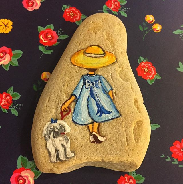 Looks like a cookie, may be a stone. Lovely art either way.