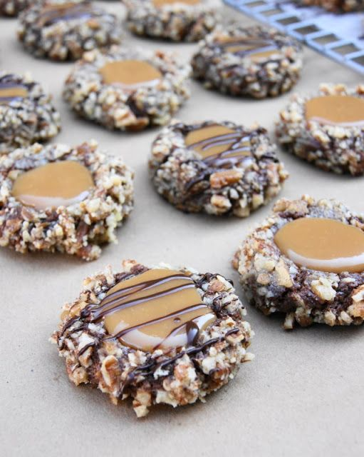 Insanely Delicious Turtle Cookies ... soft chocolate-pecan thumbprint cookies filled with caramel.  Yum! www.thekitchenismyplayground #cookies #turtle #turtlecookie