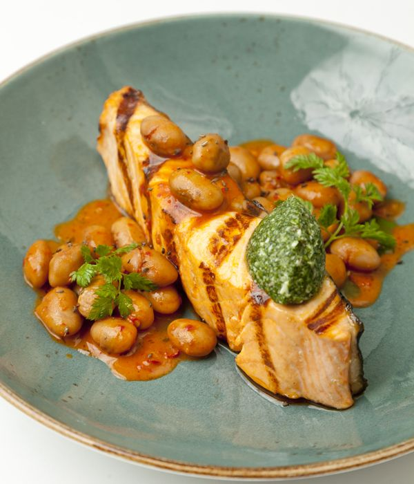 Francesco Mazzei packs some bold Italian flavours into this enticing salmon dish. The beans are cooked with stock vegetables until tender before fierce and meaty 'Nduja sausage is stirred in.