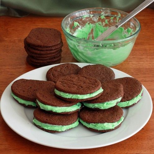 A creamy marshmallow mint filling is sandwiched between two soft and chewy chocolate cookies.