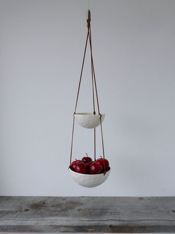 Fresh fruits are just as beautiful as they are nutritious! This hanging porcelain fruit basket is the perfect way to artfully store your produce