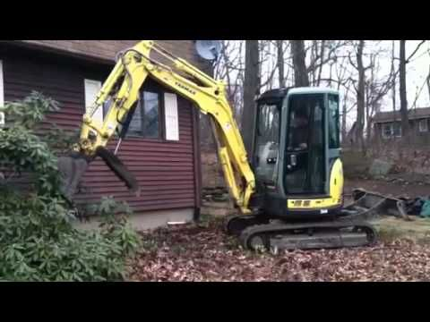 Ripping out shrubs with excavator