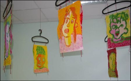 wonderfully colorful portraits and cool hanging idea