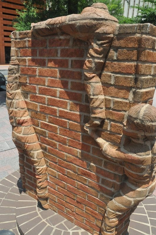 Brick children climbing a sculpture at the Green in Charlotte NC - pic **