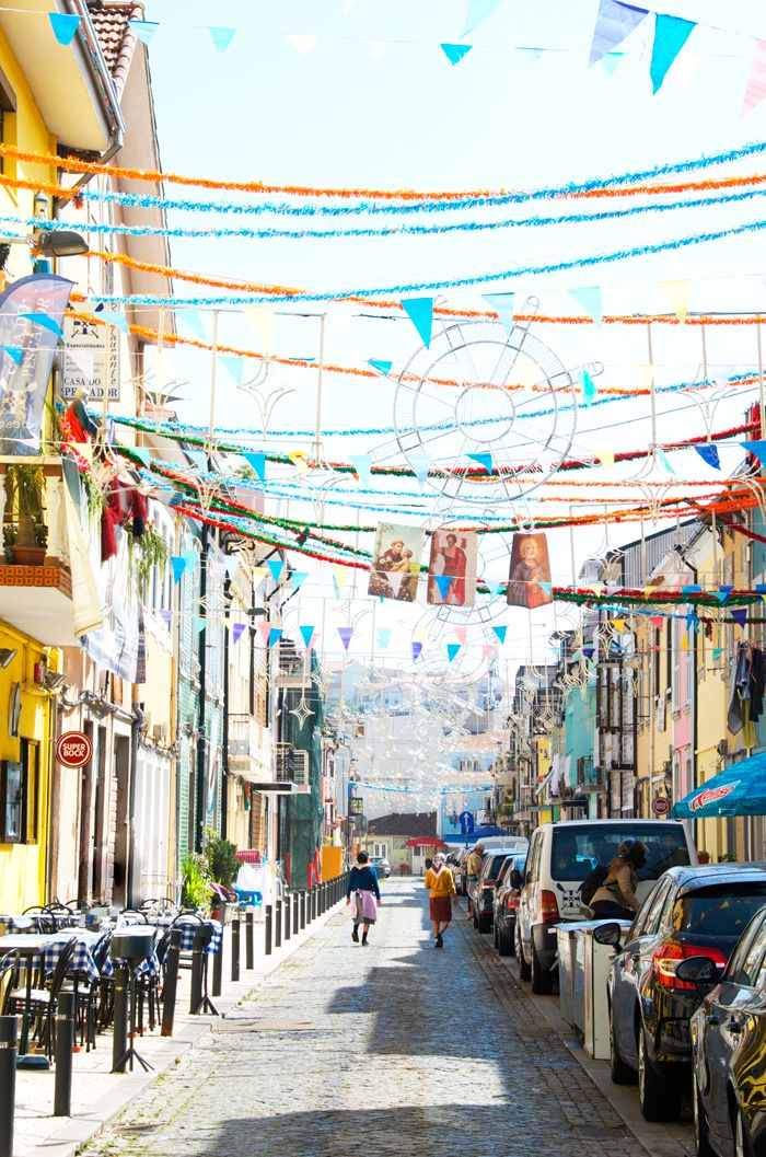 Playing In Porto Paradise   Walking through the streets of Porto is like being in a colorful dream. Each corner holds some kind of artistic, unique beauty that makes it special. What I loved most is that just about every single thing you see is somehow perfectly imperfect. From graffiti spread across the walls to broken glass on doors, it's all charming in its own way.   Portugal