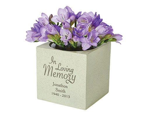This personal memorial vase is ideal for outdoor use, holding flowers for those who are no longer with us. Made from natural resin. H14.5 x W15 x D14.5cm.