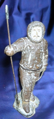 "This is another ""Mystery"".This charming figure stands 5 and 1/2"" from the bottom to the tip of his harpoon.  He's holding a real fiber rope in the other hand. I purchased this explorer figurine along with many other curious and intriguing items in Brockport, New York in 1976 excellent original condition(with the naked eye you can barely identify a repair to the ankles where it must have been broken, before I owned it.-I love a mystery.  Any ideas?"