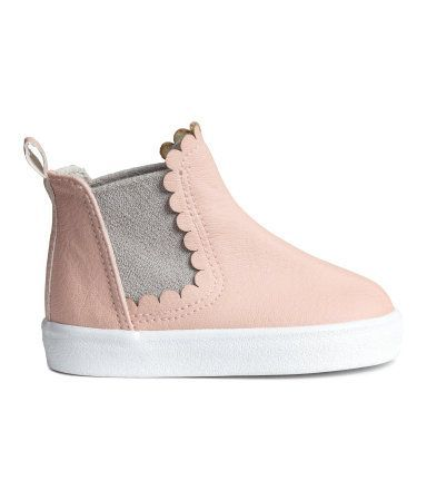 Powder pink. Chelsea-style boots in grained imitation leather. Seam at front, elastic panels at sides, scalloped edge, and loop at back. Cotton canvas