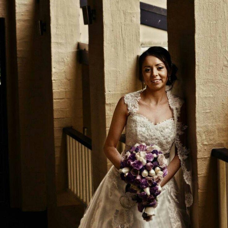 Beautiful bride Rochelle carrying a lilac purple theme teardrop bouquet