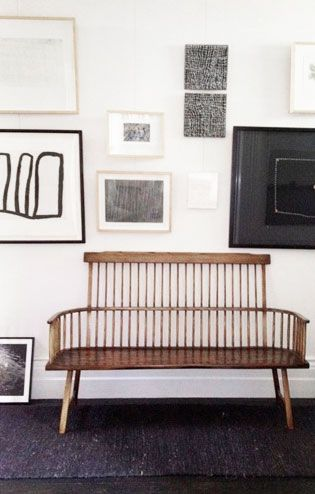 = love seat and black and white art wall