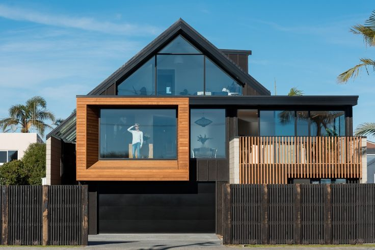 yes, we want to live here. the wood, the black, the view, the windows...oh so stunning. next level architecture in good ol nz