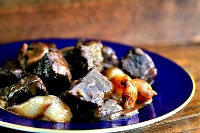 Recipe for Boeuf Bourguignon, or beef in red wine sauce, a classic French dish known for its deep rich sauce.  - Julia Child