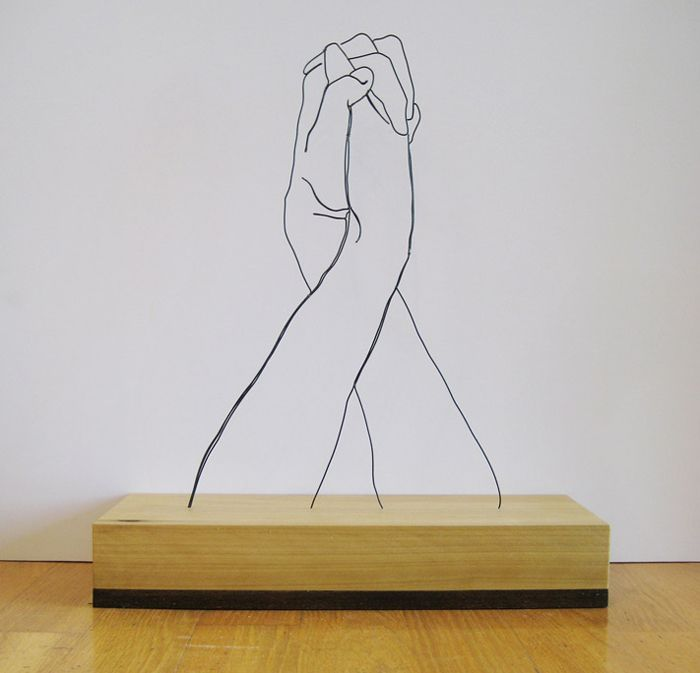 Hands Clasped  Self-taught artist, illustrator and designer Gavin Worth first became interested in wire sculpting after seeing an exhibit on Alexander Calder at the SFMoMA. Since then, he's created his own set of amazing pieces that are both beautiful and moving.