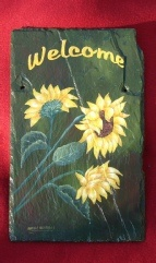 Beautiful hand painted sunflower slate painted by the artisit Sheila Santaigo....www.sheilaspaintedcreations.com.  Check out her website for slates,framed art, pet portraits, and many other uniques pieces.