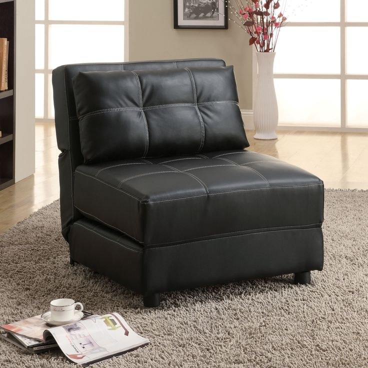 Ideal for lounging or providing a bed for your guests during a sleepover, this armless chair offers both comfort and versatility. Upholstered in decoratively stitched faux leather, this black chair adds sleek style to any decor.