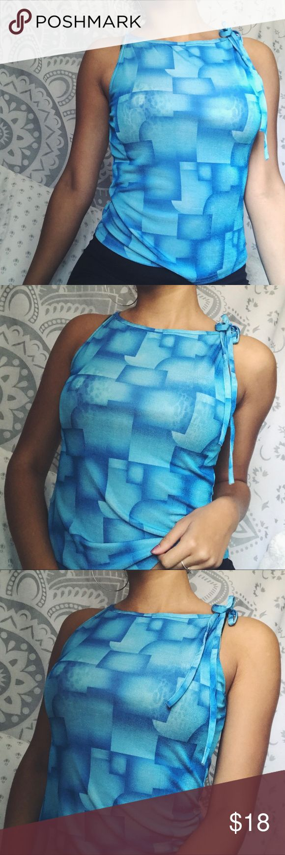 Vintage Blue Tank Top ❣️ VINTAGE BLUE TANK TOP ❣️  ••• various blues color block shirt. has a cute tie on one shoulder. great condition. perfect to pair with high waisted jeans! size small. made in usa. 90% polyester 10% spandex.   model is a small & 5'7 for ref.  •••  🌹 Bundle & Save! 🌹 No trades! 🌹 Check out my closet for more! Vintage Tops Tank Tops