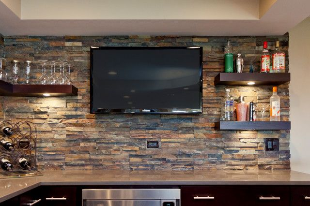 back splash of some sort, dark wood shelves, tv for bar area