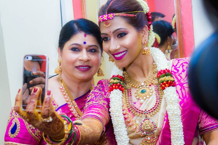 @ujjwala_n Traditional South Indian wedding. Bridal bride dressed up. Bride and mother. gold jewellery. antique temple jewellery. Bridal makeup hairstyle. Aanchal balraj. Pink kanchivaram saree. indian wedding south indian