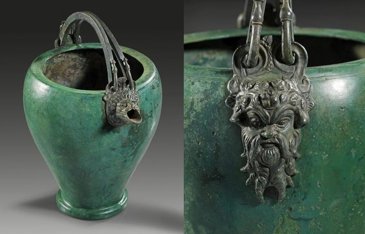 Greek bronze situla, 2nd half 4th century B.C. The pear-shaped body on a raised ring foot, the two handles hooked through a double foliate ring on either side that springs from plastical attachments of excellent quality, one depicting the head of a Silenus, the other in form of a lion´s head with spout, 22.5 cm high. Private collection