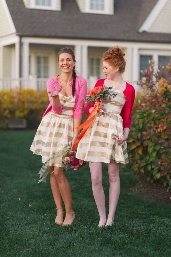 Cute bridesmaids in gold and white striped dresses