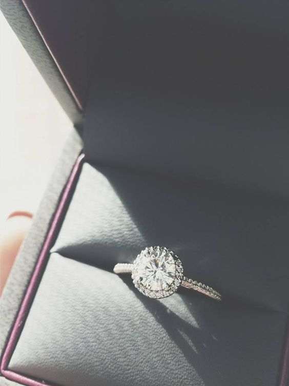 Round halo engagement rings are such a classic! Find this and more on HowHeAsked's engagement ring finder.