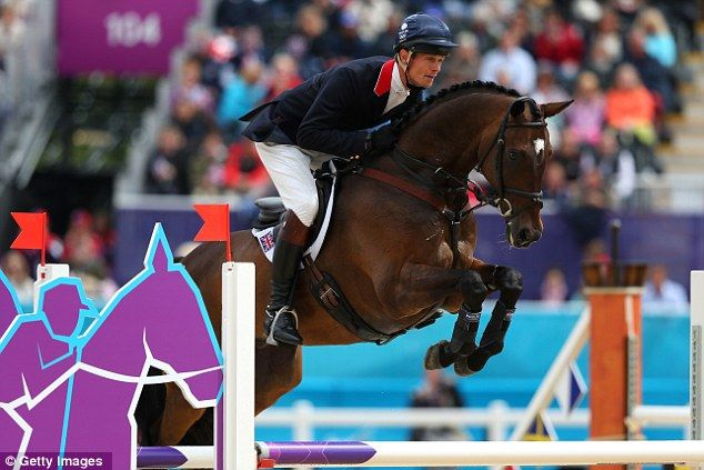 Zara Phillips' team-mate William Fox-Pitt and his horse Lionheart go for gold in the showjumping event
