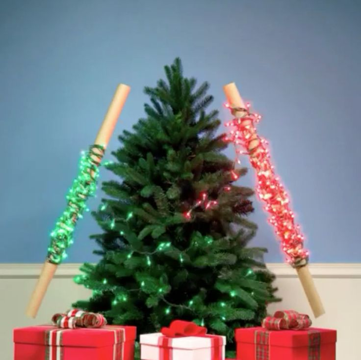 Wrap Christmas lights around gift wrapping tubes for easy storage in an attic far, far away #lowesfixinsix
