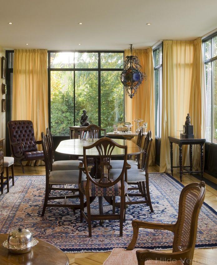 Oranjerie als woonuitbreiding, aluminium veranda met mooi antiek meubilair | De Mooiste Veranda's