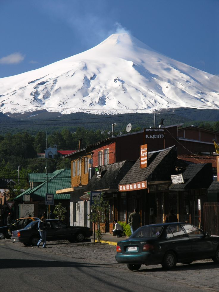 Pucón. The town of Pucón by the Villarica Lake. In the background is  the snow-capped Villarrica volcano.