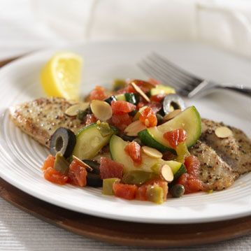 Flaky tiliapia fillets topped with spicy tomatoes, zucchini, olives, capers and toasted almonds
