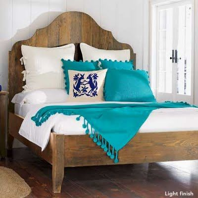 Otomi pillow in blue with turquoise bedspread