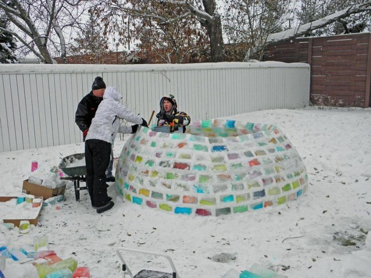 If you live in a cold climate, this would be fun.  Save milk cartons.  Fill with colored water and leave outside to freeze.  Then build a fort or igloo.  See the site for pretty pics of the igloo at night with a light inside.