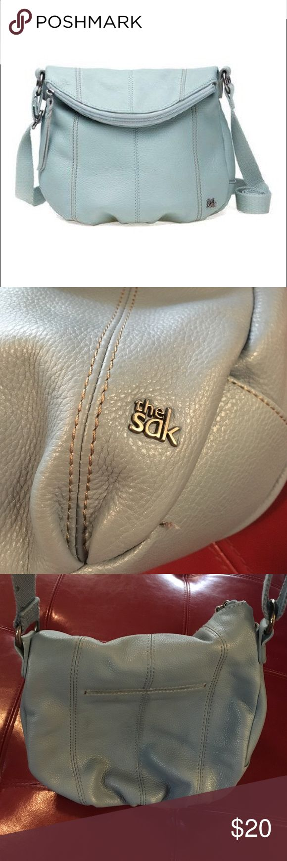 The SAK  Crossbody bag perfect for festivals Genuine leather Crossbody bag made by the sack perfect for festivals. Multiple inside pockets including zip in and zip pockets second opening for additional storage plus easy slide on back to reach phone The Sak Bags Crossbody Bags