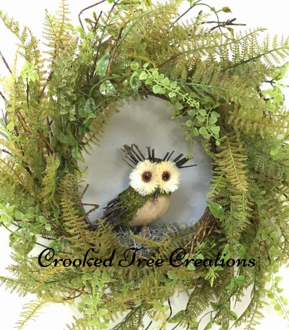 Welcome the season with this beautiful new design from Crooked Tree Creations. Assembled on a grapevine base, this lovely wreath boasts and abundance of rich woodland greenery and ferns which surround a sweet burlap owl. This rustic wreath would be suitable for display throughout