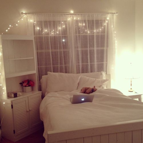 Simple bedroom #fairylights draped around the back of the bedroom