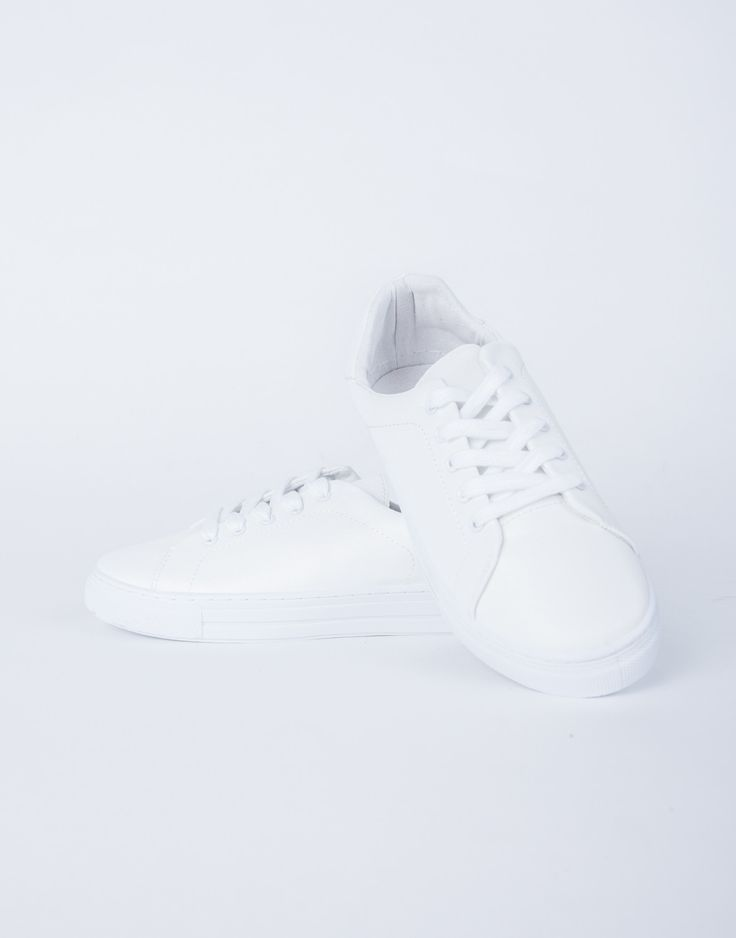 White sneakers are the talk of this season. These White Out Sneakers are made from a faux leather fabric. Features lace-up strings, round toe construction, flatform height, and padded insole cushion f