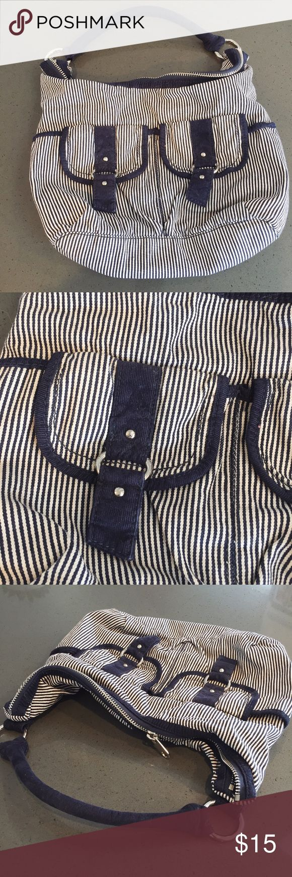 "American Eagle Purse American Eagle Purse in navy/white stripes and silver hardware. Barely used, in excellent condition. Two outside pockets. Inside there's one zip pocket and 2 open open pockets. Flat measurements (approximate): 15"" width, 9"" height, 6"" depth. American Eagle Outfitters Bags Hobos"